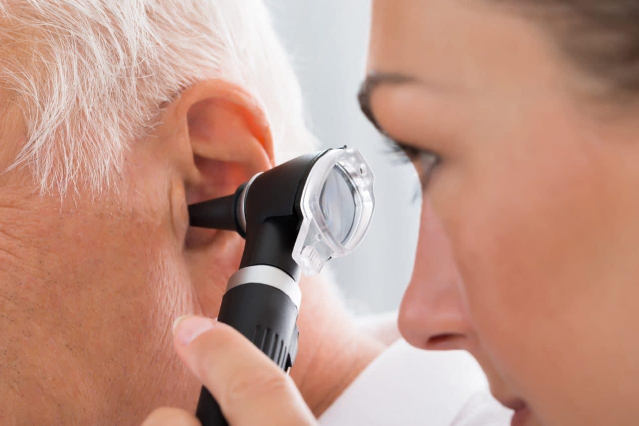 A patient having an otoscope examination